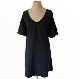 Black shift dress with short bell sleeves